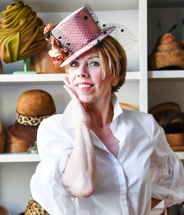 Berry Rutjes in front of her hat blocks at her atelier in Gouda